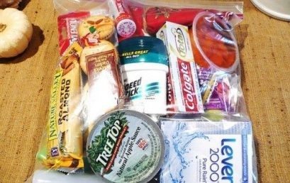 Assemble and distribute care packages for the homeless with SDYP